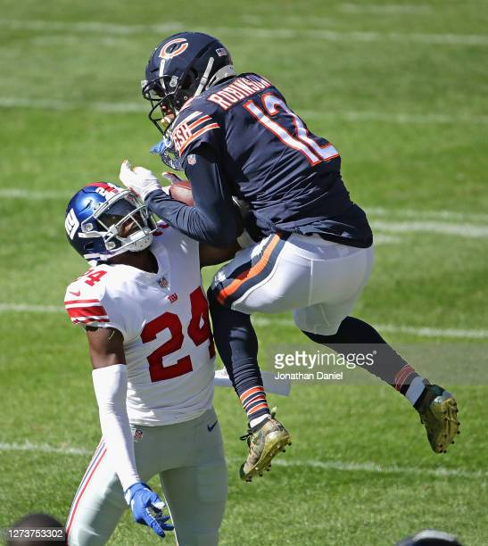 James Bradberry of the New York Giants intercepts a pass intended for Allen Robinson of the Chicago Bears at Soldier Field on September 20, 2020 in...