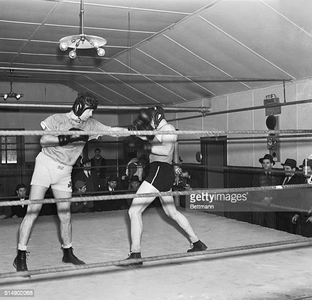 James Braddock left former world's heavyweight champion boxing with a sparring partner at his camp at Pompton Lakes NJ Jan 13th where he is training...