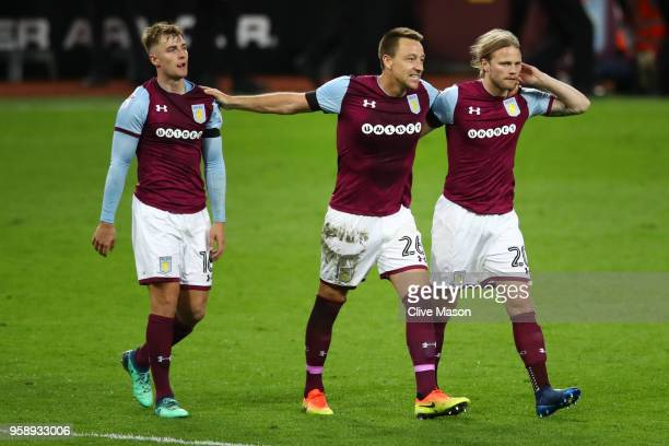 James Bree of Aston Villa John Terry of Aston Villa and Birkir Bjarnason of Aston Villa celebrate at the full time whistle during the Sky Bet...