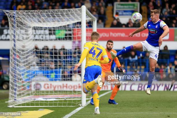 James Bree of Ipswich Town clears the ball after a shot from Jack Clarke of Leeds United during the Sky Bet Championship match between Ipswich Town...