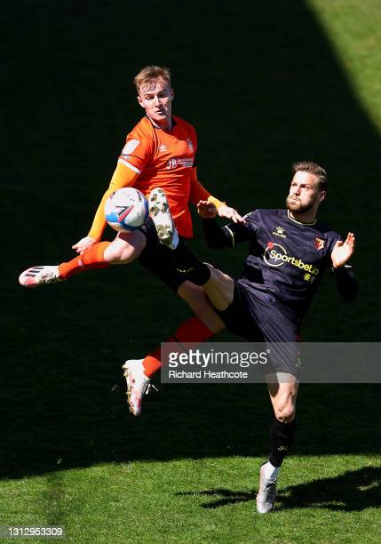 James Bree of Luton Town battles for possession with Philip Zinckernagel of Watford FC during the Sky Bet Championship match between Luton Town and...