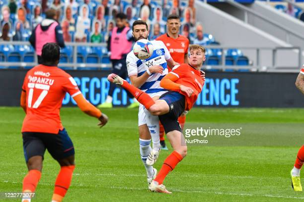 James Bree of Luton town battles for possession with Yoann Barbet of QPR during the Sky Bet Championship match between Queens Park Rangers and Luton...