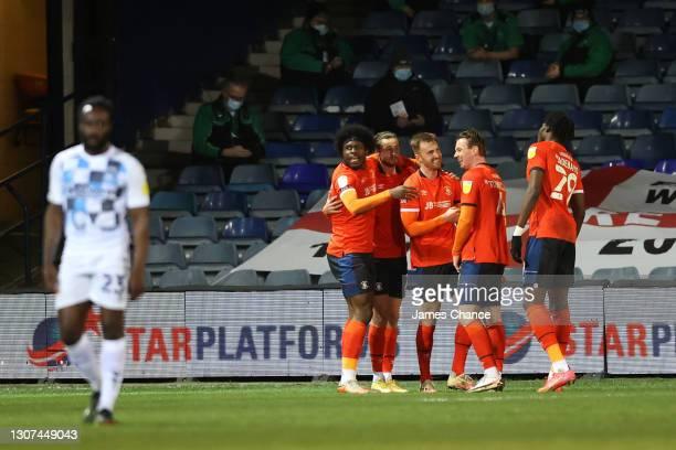 James Bree of Luton Town celebrates with Pelly Ruddock Mpanzu, Harry Cornick, Ryan Tunnicliffe and Elijah Adebayo after scoring their team's first...