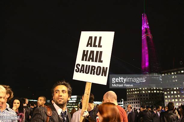 """James Bridle holds a sign reading """"All Hail Sauron"""" on London Bridge, during the inauguration ceremony for the Shard skyscraper."""