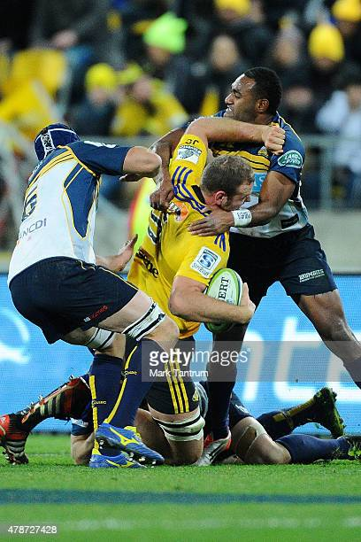 James Broadhurst gets tackled during the Super Rugby Semi Final match between the Hurricanes and the Brumbies at Westpac Stadium on June 27 2015 in...