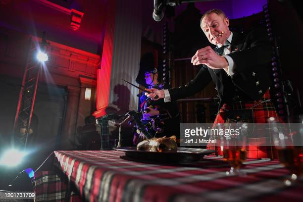 James Brodie addresses the haggis during the Burns Beyond traditional Burns Supper in the Freemasons Hall on January 24 2020 in Edinburgh Scotland...