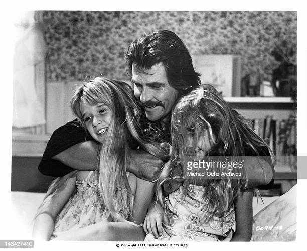James Brolin shares a tender moment with his daughters Kim and Kyle Richards in scene from the film 'The Car' 1977
