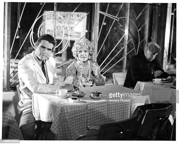James Brolin sits next to Claire Trevor in a scene from the film 'The Cape Town Affair' 1967