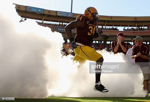 James Brooks of the Arizona State Sun Devils runs out onto the field before the college football game against the Oregon State Beavers at Sun Devil...