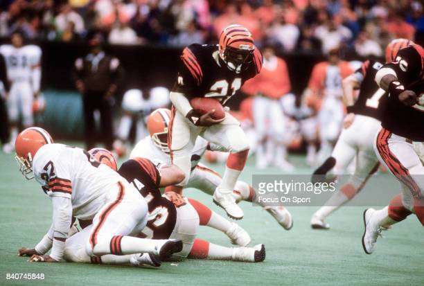 James Brooks of the Cincinnati Bengals carries the ball against the Cleveland Browns during an NFL football game circa 1988 at Riverfront Stadium in...