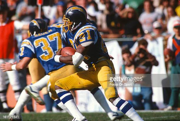 James Brooks of the San Diego Chargers carries the ball against the Miami Dolphins during the AFC Divisional Playoff football game January 16 1983 at...