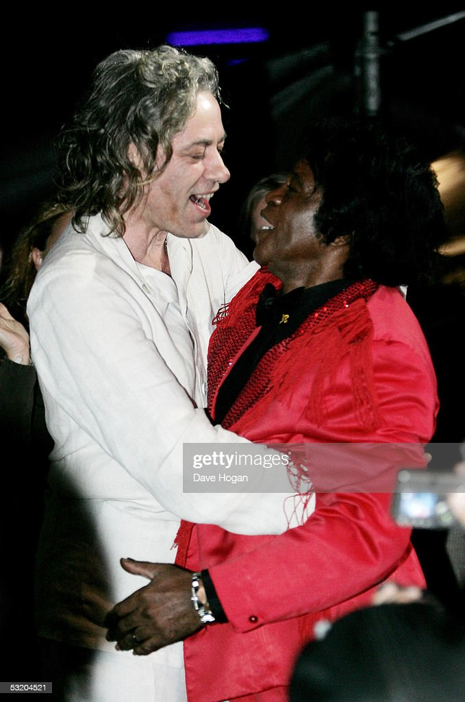 James Brown (R) and Bob Geldof are seen on stage at the Live 8 Edinburgh concert at Murrayfield Stadium on July 6, 2005 in Edinburgh, Scotland. The free gig, labelled Edinburgh 50,000 - The Final Push, is organised by Midge Ure, alongside Geldof, and coincides with the G8 summit to raise awareness for MAKEpovertyHISTORY.