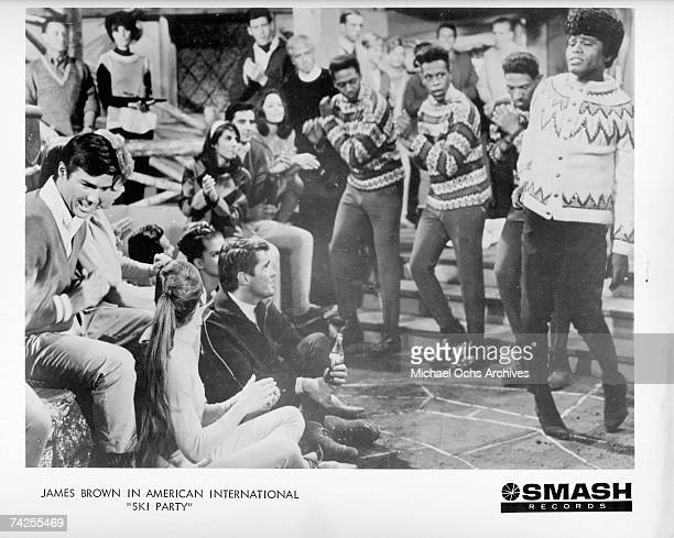 James Brown and the Famous Flames perform 'I Got You I Feel Good' at a ski lodge on the set of American International Pictures 'Ski Party' in 1965 in...