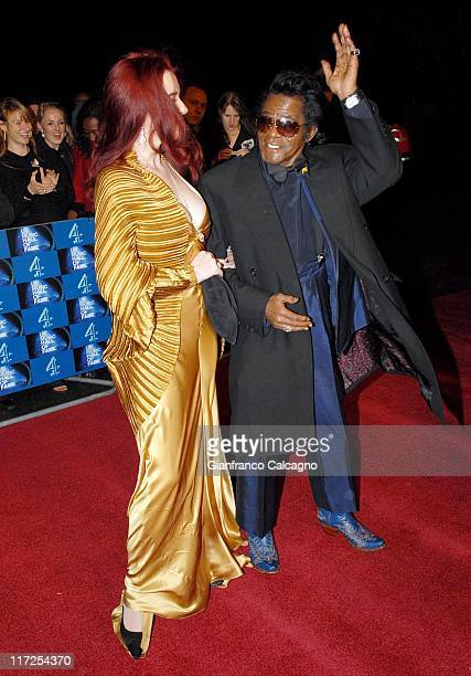 James Brown and wife Tomi Rae Hynie during UK Music Hall Of Fame 2006 Arrivals at Alexandra Palace in London Great Britain