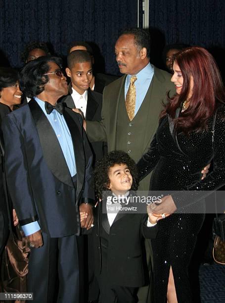 James Brown, Jesse Jackson, James Brown's son James Jr. And wife Tomi Rae Hynie