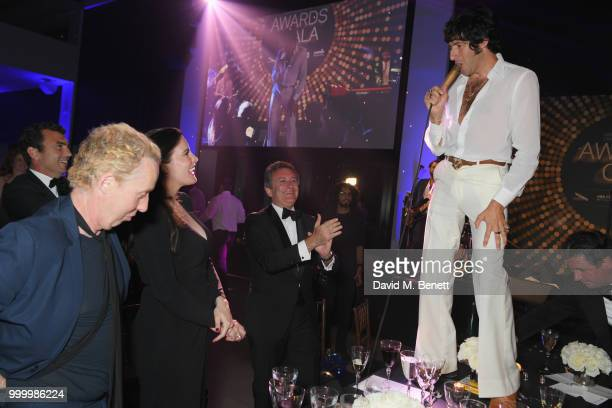 James Brown Liv Tyler and Formula E CEO Alejandro Agag watch a performer at the 2017/18 ABB FIA Formula E Championship Awards Dinner following the...