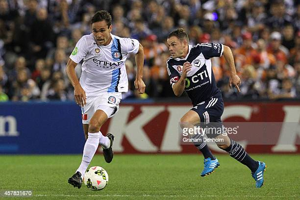 James Brown of Melbourne City is chased by Leigh Broxham of Melbourne Victory during the round three ALeague match between the Melbourne Victory and...