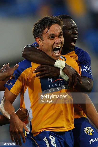 James Brown of United celebrates after scoring during the round one A-League match between Gold Coast United and Wellington Phoenix at Skilled Park...