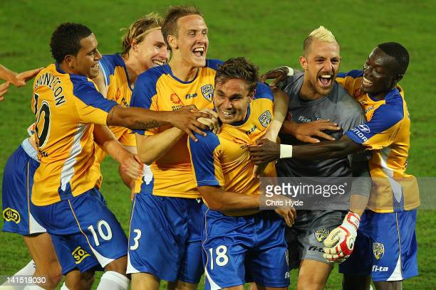 James Brown of United celebrates with team mates after scoring his second goal during the round 24 A-League match between Gold Coast United and Perth...