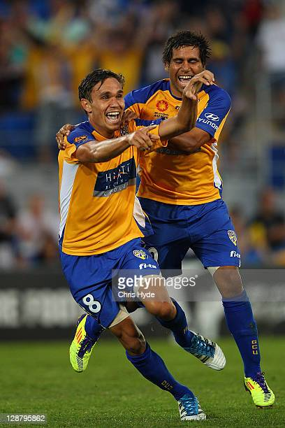 James Brown of United celebrates with teammate Tahj Minniecon after scoring during the round one A-League match between Gold Coast United and...