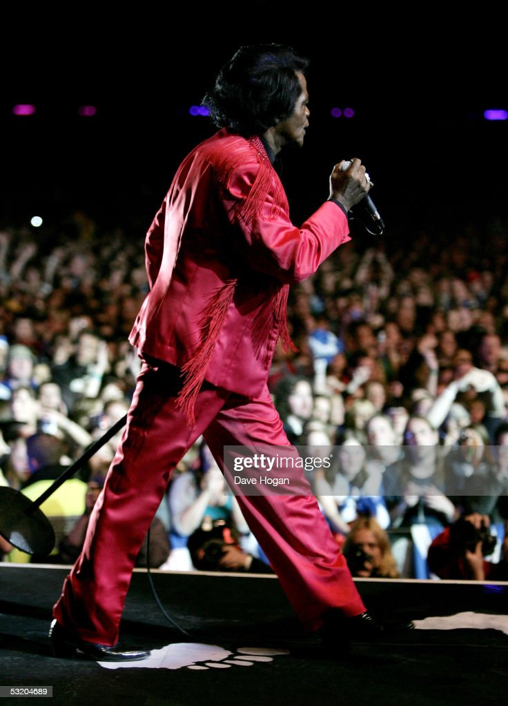James Brown performs on stage at the Live 8 Edinburgh concert at Murrayfield Stadium on July 6, 2005 in Edinburgh, Scotland. The free gig, labelled Edinburgh 50,000 - The Final Push, is organised by Midge Ure, alongside Sir Bob Geldof, and coincides with the G8 summit to raise awareness for MAKEpovertyHISTORY.