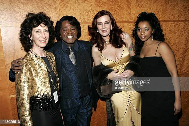 James Brown wife Tomi Rae Hynie and guests during Universal Music Group 2005 PostGRAMMY Party at The Palms Restaurant in Los Angeles California...