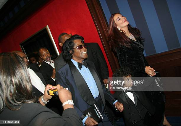 James Brown with his wife Tomi Rae Hynie and son James Jr