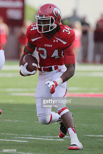 """James """"Bubba"""" Poole of the Utah Utes runs the ball during a game against the Stanford Cardinal during the first half of an NCAA football game October..."""