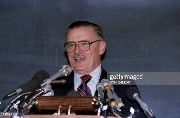 James Buchanan flashes a smile at a news conference here 16 October 1986 at George Manson University after it was announced that he is the winner of...