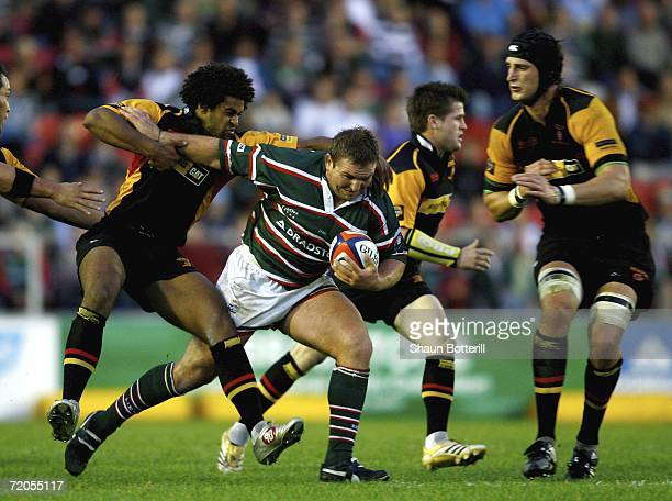 James Buckland of Leicester Tigers is tackled by Colin Charvis of Dragons during the EDF Energy Anglo Welsh Cup match between Leicester Tigers and...