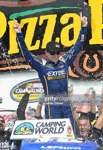James Buescher driver of the Exide Chevrolet celebrates after winning the NASCAR Camping World Truck Series Fan Appreciation 200 presented by New...