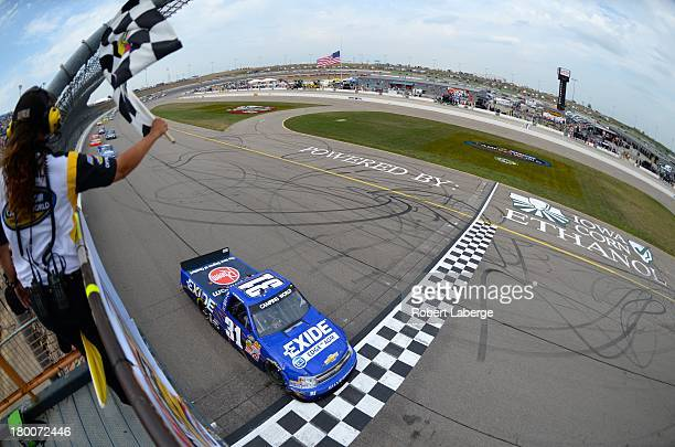 James Buescher driver of the Motomaster Eliminator Chevrolet crosses the finish line to win the NASCAR Camping World Truck Series Fan Appreciation...
