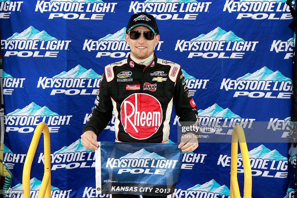 James Buescher, driver of the #31 Rheem Chevrolet, poses with the Kesystone Light Pole award after during qualifying for the NASCAR Camping World Truck Series SFP 250 at Kansas Speedway on April 20, 2013 in Kansas City, Kansas.