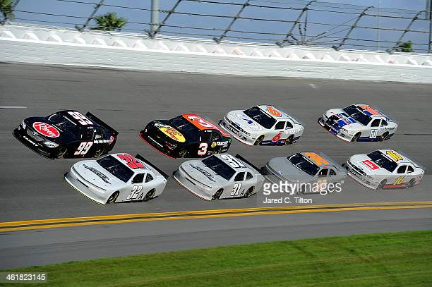 James Buescher driver of the Rheem Toyota and Kyle Larson driver of the Turner Motorsports Chevrolet lead a pack of cars during NASCAR Preseason...