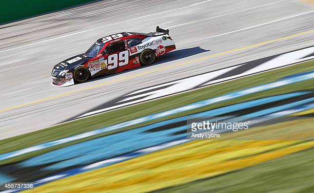 James Buescher driver of the ToyotaCare Toyota drives during practice for the NASCAR Nationwide Series VisitMyrtleBeachcom 300 at Kentucky Speedway...