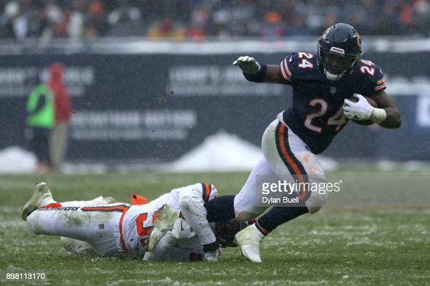 James Burgess of the Cleveland Browns grabs Jordan Howard of the Chicago Bears in the third quarter at Soldier Field on December 24 2017 in Chicago...