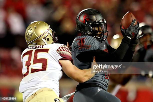 James Burgess of the Louisville Cardinals intercepts a pass thrown by Jameis Winston of the Florida State Seminoles in the second quarter during...