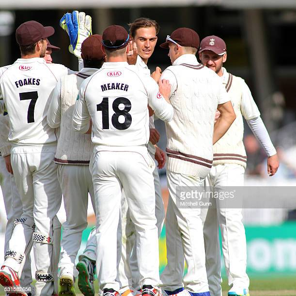 James Burke of Surrey celebrates the wicket of Adam Voges of Middlesex during the Specsavers County Championship Division One match between Surrey...