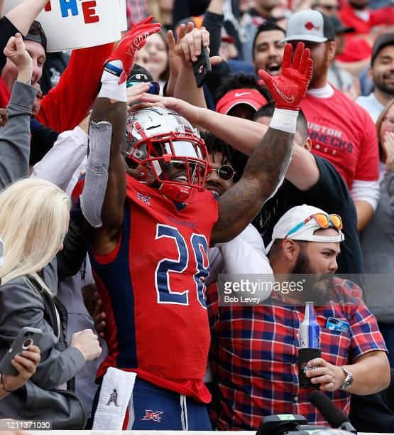 James Butler of the Houston Roughnecks celebrates a touchdown against the Seattle Dragons with the fans during a XFL football game at TDECU Stadium...