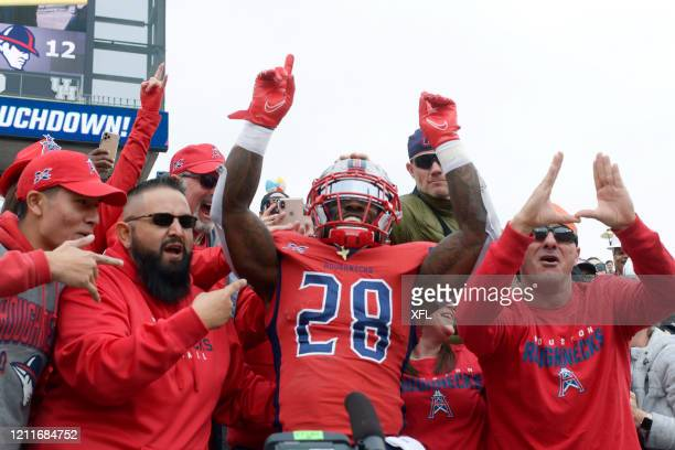 James Butler of the Houston Roughnecks celebrates with fans after a touchdown during the XFL game against the Seattle Dragons at TDECU Stadium on...