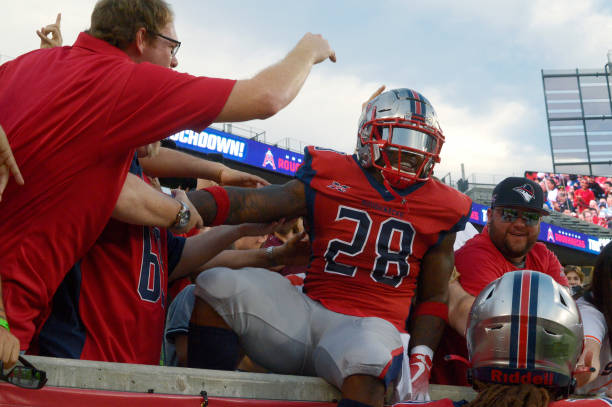 James Butler of the Houston Roughnecks celebrates with fans during the XFL game against the St Louis BattleHawks at TDECU Stadium on February 16 2020...