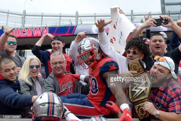 James Butler of the Houston Roughnecks celebrates with fans during the XFL game against the Seattle Dragons at TDECU Stadium on March 7 2020 in...