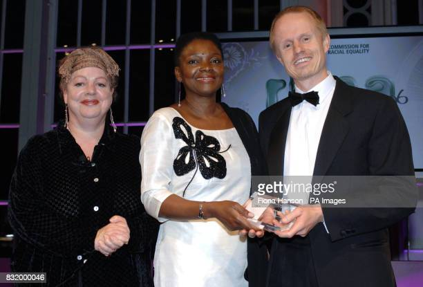 James Button of the Sydney Morning Herald and Melbourne Age collects the International award for the newspapers from Baroness Amos centre accompanied...