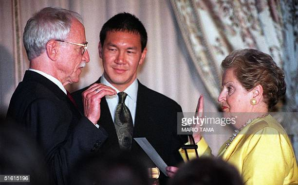 James C. Hormel is sworn in as US Ambassador to Luxembourg by Secretary of State Madeleine Albright at the State Department 29 June 1999 in...