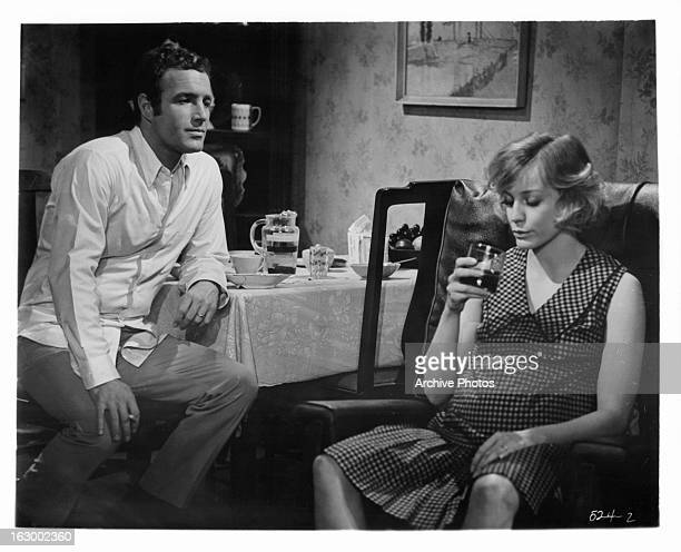 James Caan looks to Carrie Snodgress in a scene from the film 'Rabbit Run' 1970