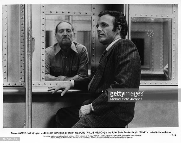James Caan visits his old prison mate Willie Nelson in a scene from the United Artist movie Thief circa 1981