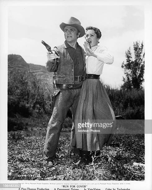 James Cagney defends Viveca Lindfors in a scene from the film 'Run For Cover' 1955