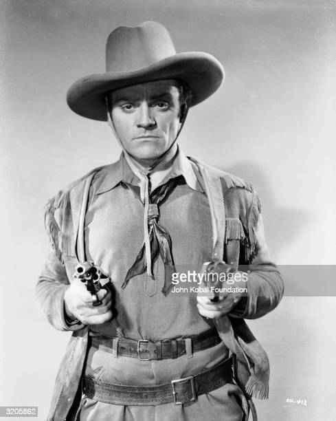 James Cagney draws his guns in the film 'The Oklahoma Kid' in which he starred alongside Humphrey Bogart