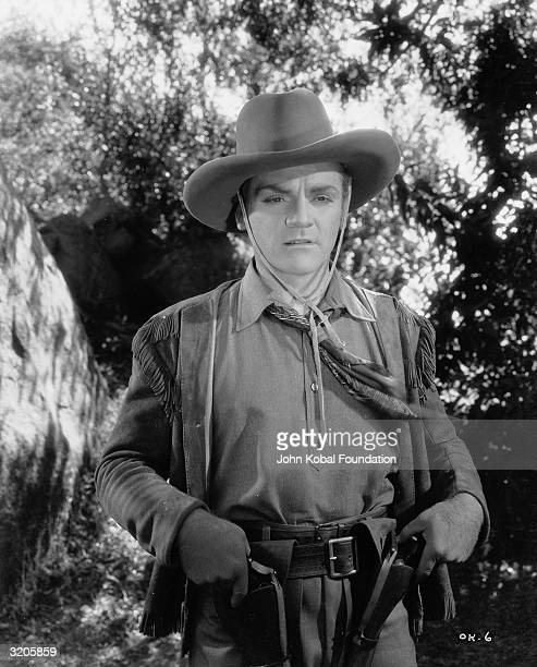 James Cagney reins in his killer instinct and holsters his guns in the film 'The Oklahoma Kid' in which he starred alongside Humphrey Bogart