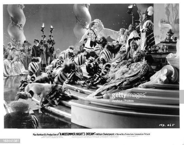 James Cagney standing on top of stairs addressing royalty in a scene from the film 'A Midsummer Night's Dream' 1935
